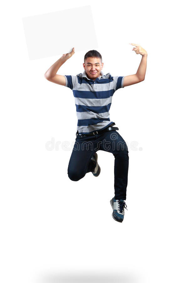 Teenager boy jumping and holding blank paper. Isolated over white stock photo