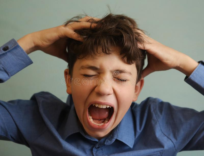 Teenager boy scratching head itch because of lice. Close up photo royalty free stock image