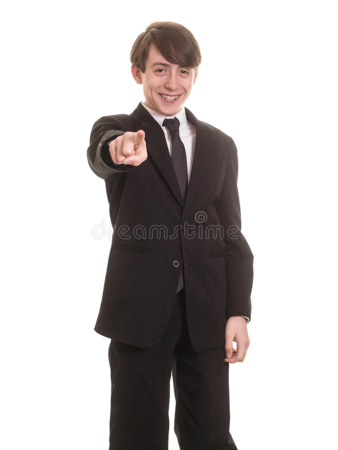 Teen boy smiling and pointing stock image