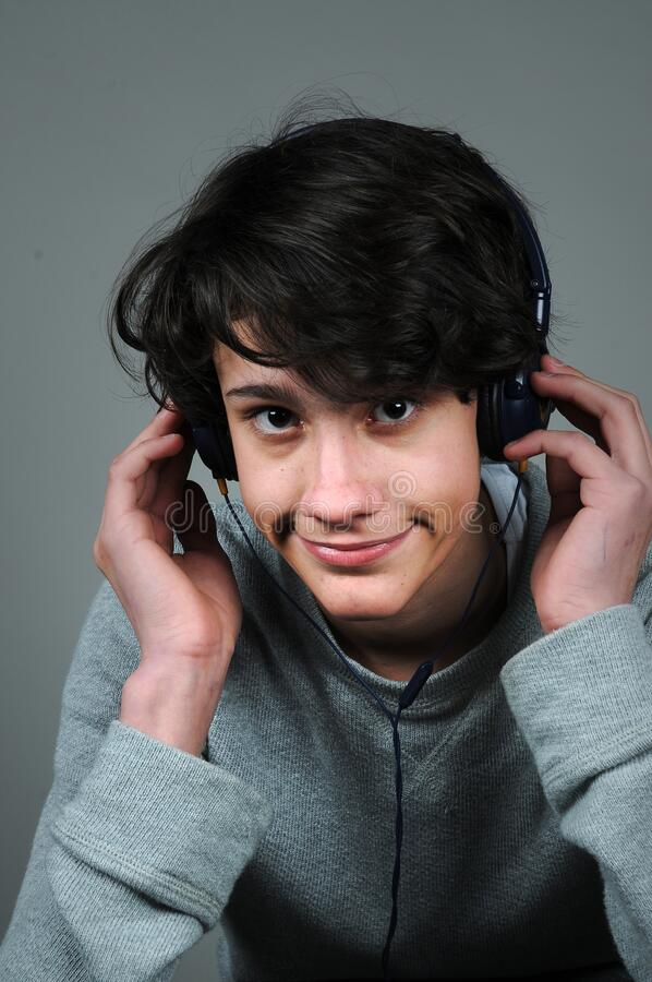 Free Teenager Boy With Earphones  Listeningt O The  Music Royalty Free Stock Images - 217284259