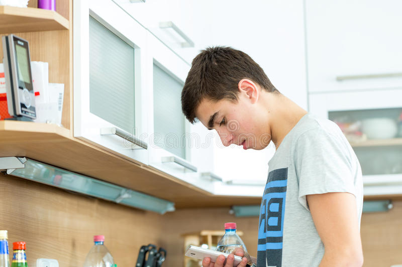 Teenager boys play on smartphone stock images