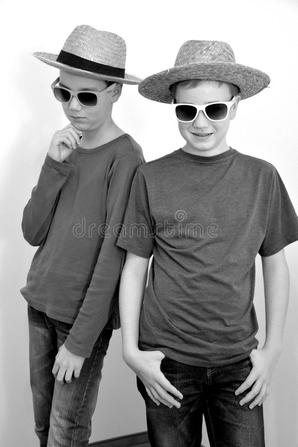 Teenager boys with straw hat stock images