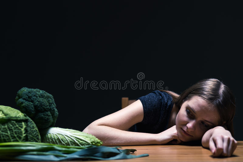Teenager with bulimia. Young pretty teenager on diet with bulimia royalty free stock photo