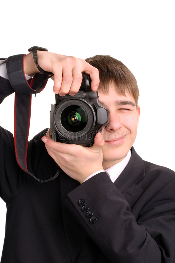 Teenager with camera. A young teenager gets ready to take a photograph stock images
