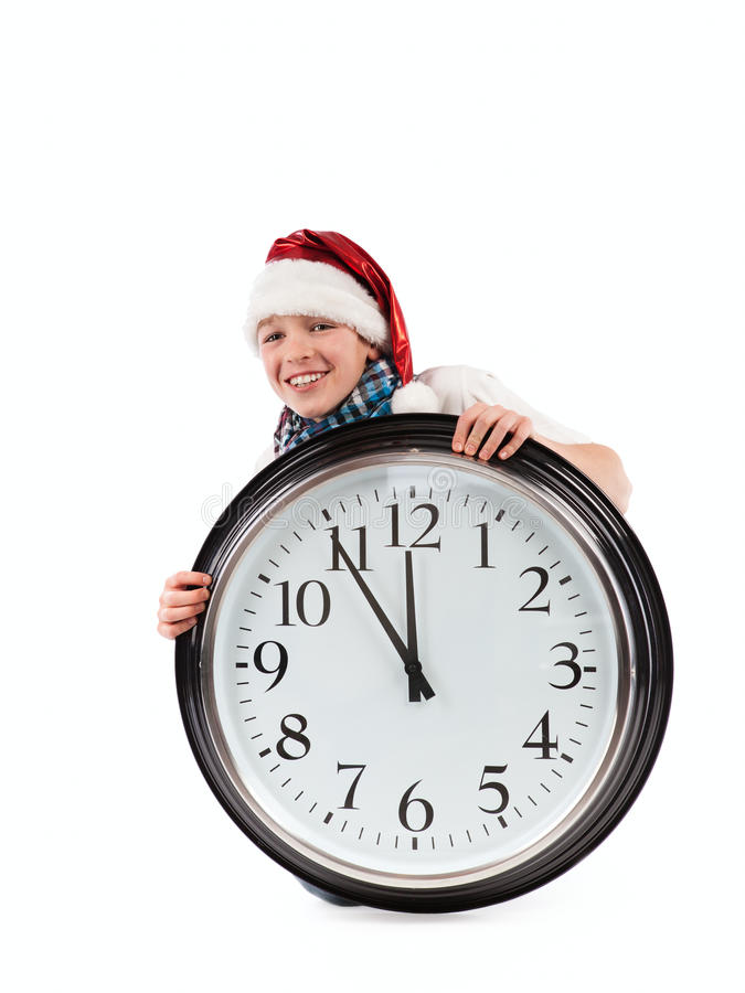 Download Teenager In Cap Of Santa Claus And Large Clock Stock Photos - Image: 27459403