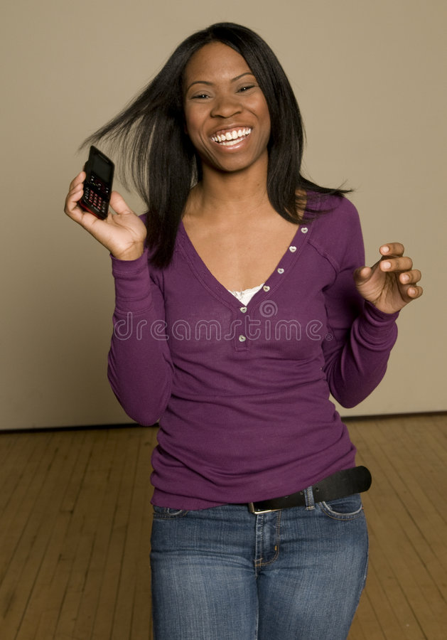 Teenager with cellphone royalty free stock photos