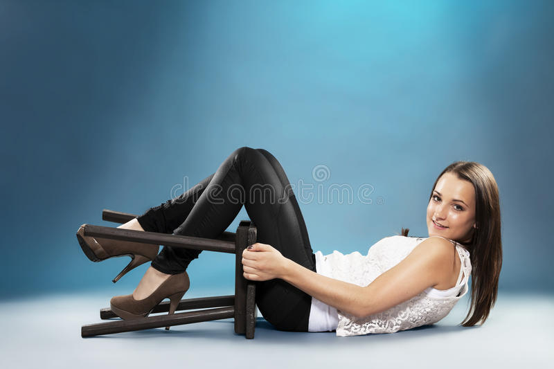Download Teenager With A Chair Lying On The Floor Stock Image - Image: 28728757
