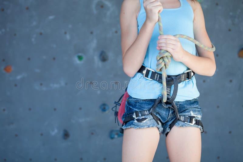 Teenager climbing a rock wall stock photography