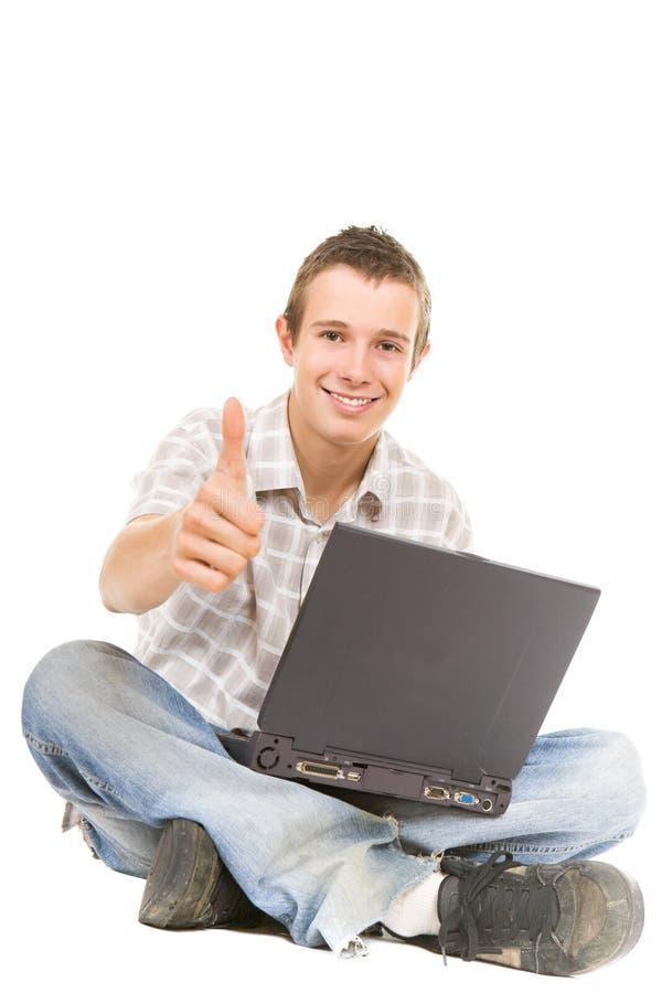 Teenager con il computer portatile immagini stock libere da diritti