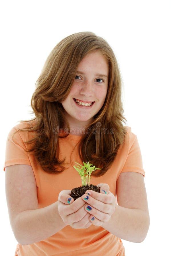 Teenager con la pianta fotografia stock libera da diritti