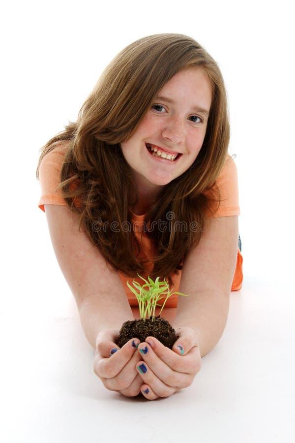 Teenager con la pianta immagini stock
