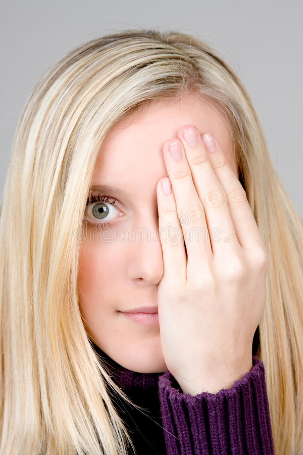 Teenager Covering One Eye Stock Image