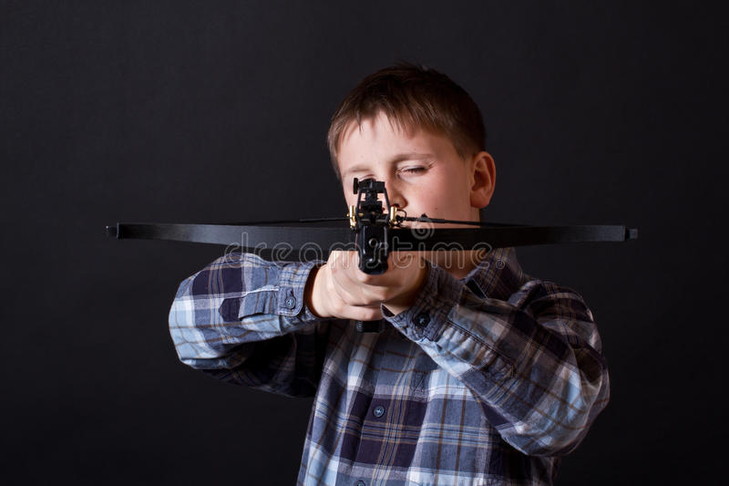 Download Teenager with a crossbow stock image. Image of crossbowman - 28231173