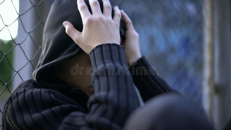 Teenager crying, school bullying, dysfunctional family, loneliness or depression stock photo