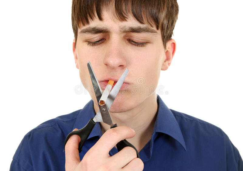 Teenager cutting a Cigarette royalty free stock images