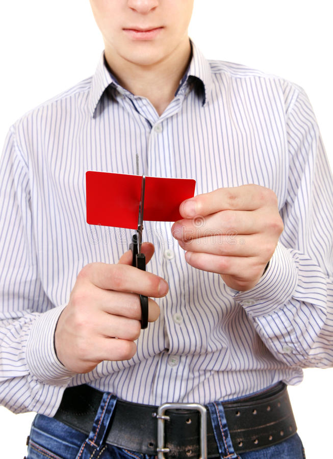 Teenager cutting a Credit Card royalty free stock photography