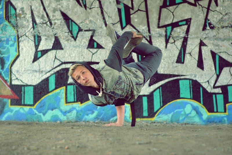Teenager dancing break dance on the street. Nice teenager dancing break dance on the street royalty free stock photos