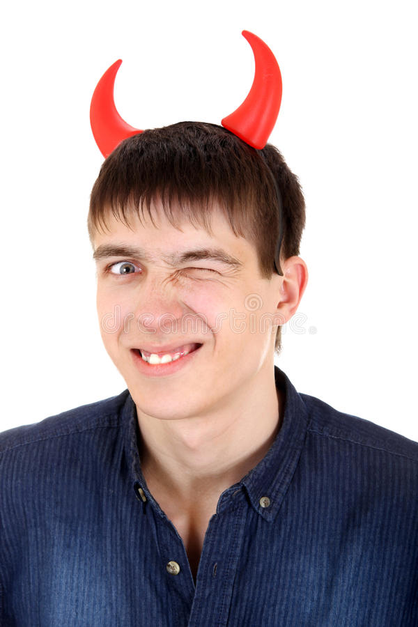 Teenager with Devil Horns. Sly Teenager with Devil Horns on the Head Isolated on the White Background royalty free stock images