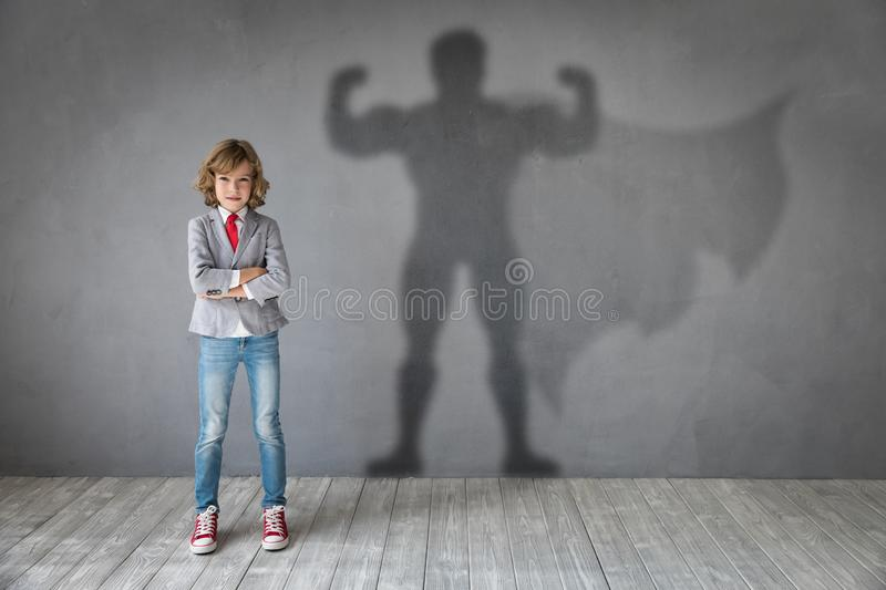Teenager dreams of becoming a super hero. Young girl wants to become a super hero. Teenager dreams of becoming a superhero. Imagination and motivation concept stock photo