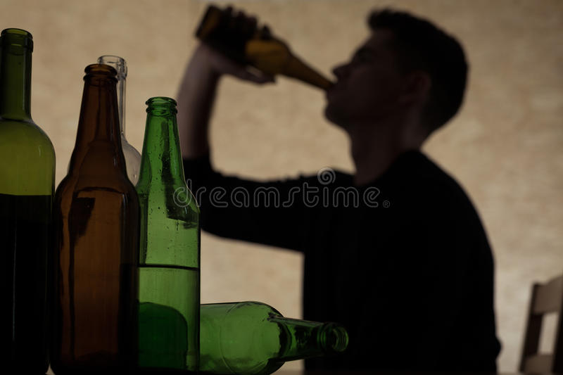 Teenager drinking beer royalty free stock photo