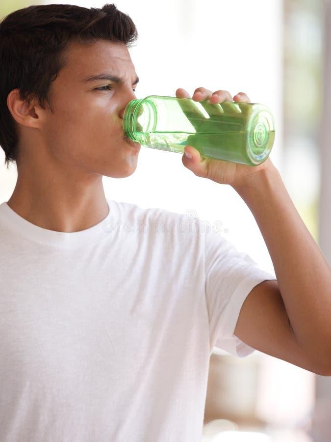 Teenager drinking water royalty free stock image