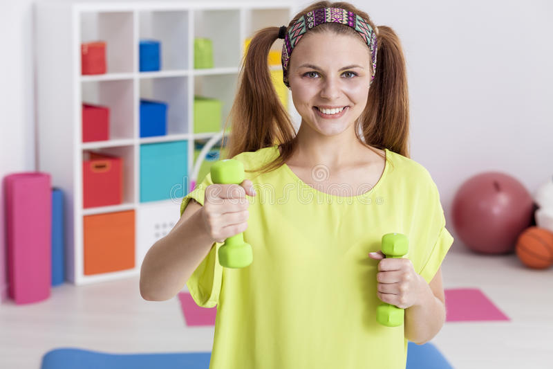 Teenager with dumbbells stock photo