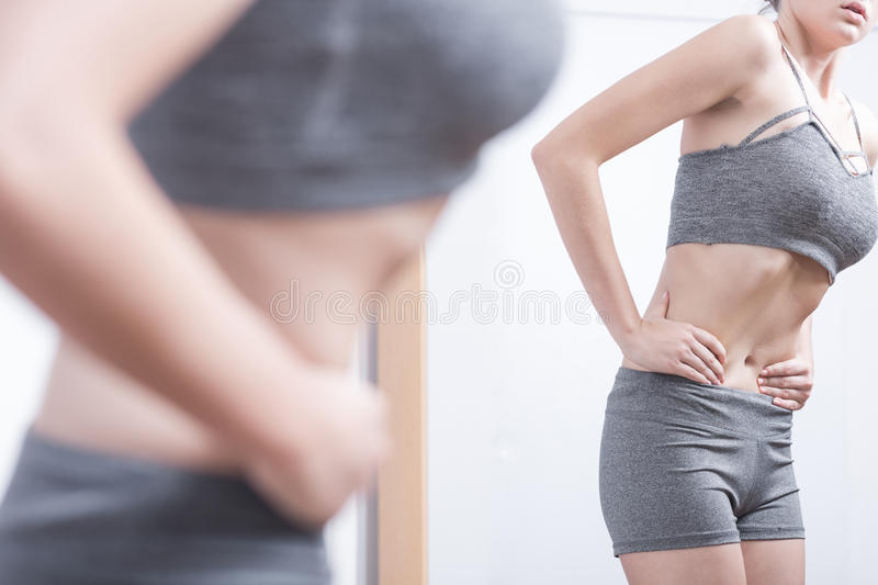 Teenager with eating disorder stock images