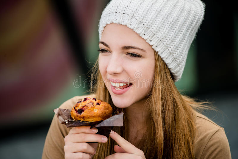 Teenager eating muffin stock images