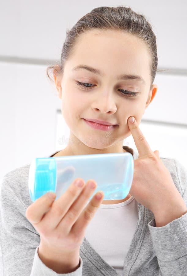 Teenager, facial skin care stock images