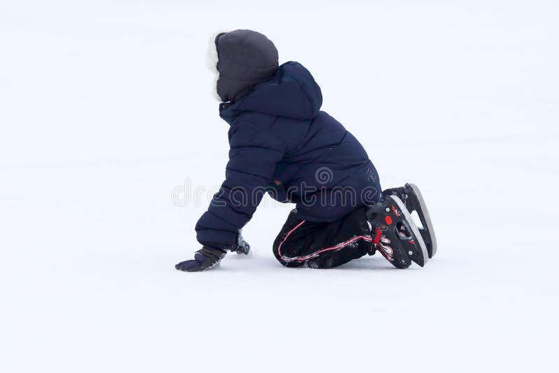 Teenager fell while skating on ice royalty free stock photography