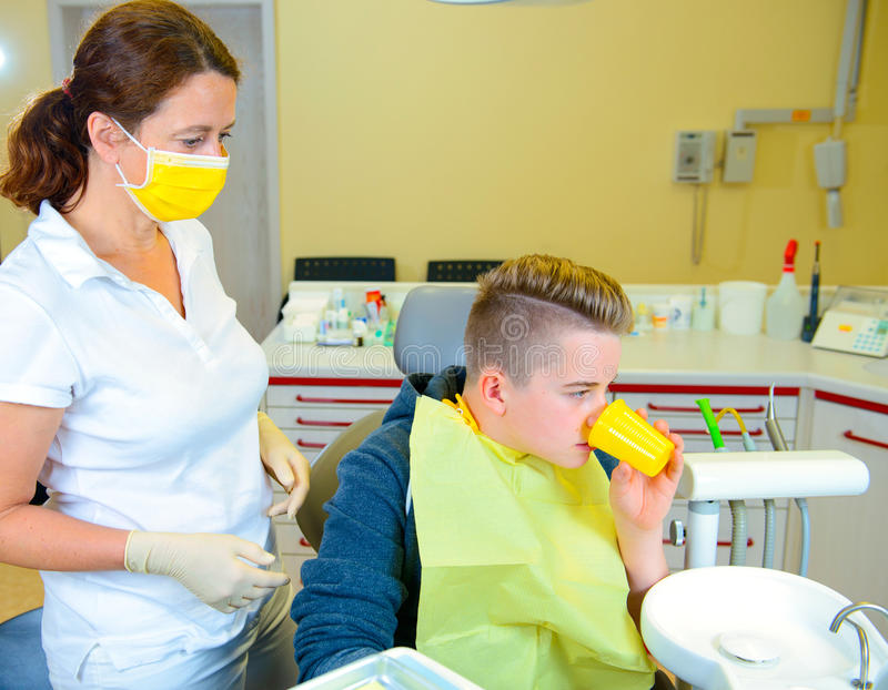 Download Teenager At A Female Dentist`s Surgery Stock Photo - Image: 83708988