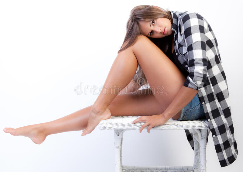 Teenager in Flannel Shirt and Jean Shorts stock images