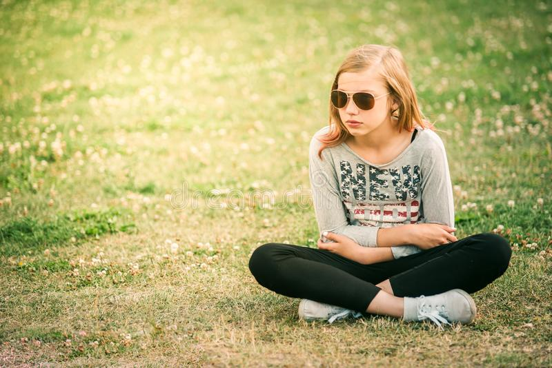 Teenager flower hippie girl enjoying summer festival. 10 years o. Teenager flower hippie girl enjoying summer. 10 years old girl stock photo