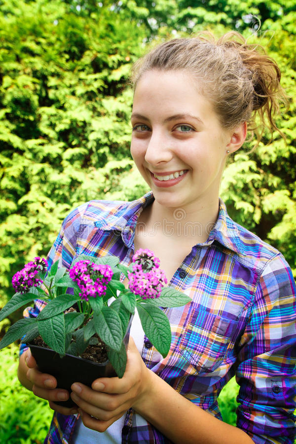 Teenager with flowers royalty free stock image