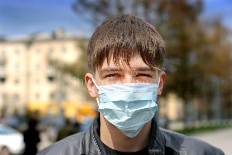 Download Teenager In Flu Mask Royalty Free Stock Photos - Image: 26446958