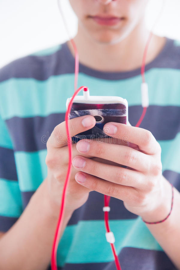 Teenager with gadget. Boy teenager playing with his gadget royalty free stock images