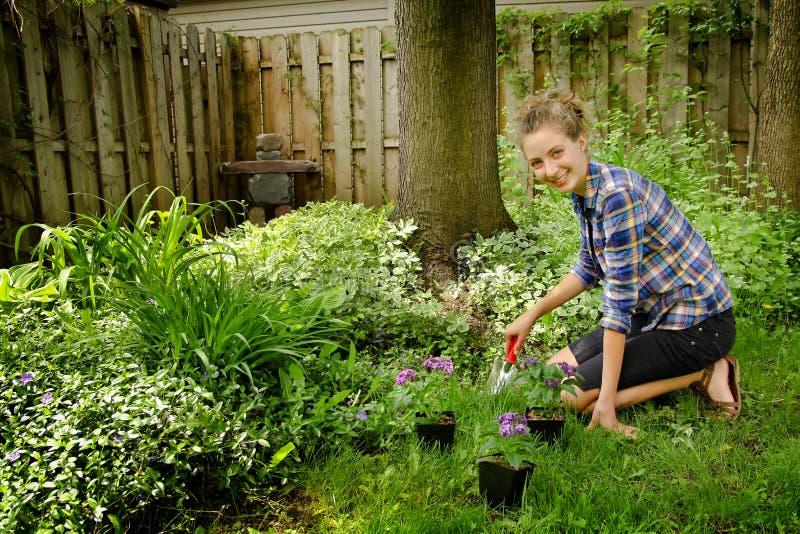 Teenager gardening royalty free stock photos