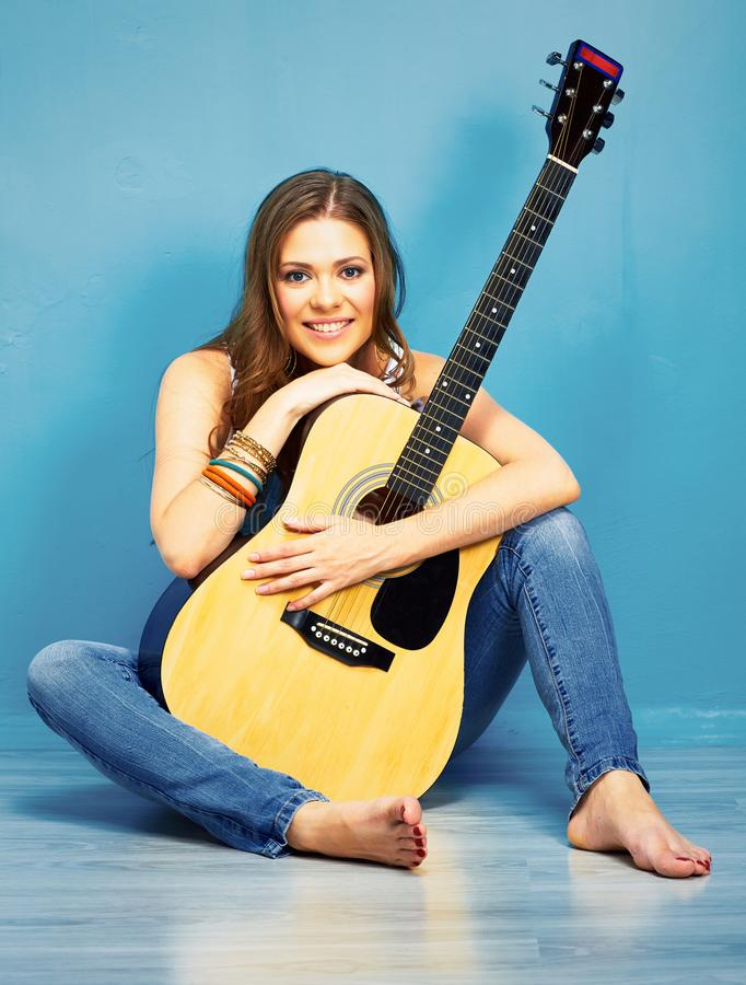 Teenager girl with acoustic guitar in city style stock photography