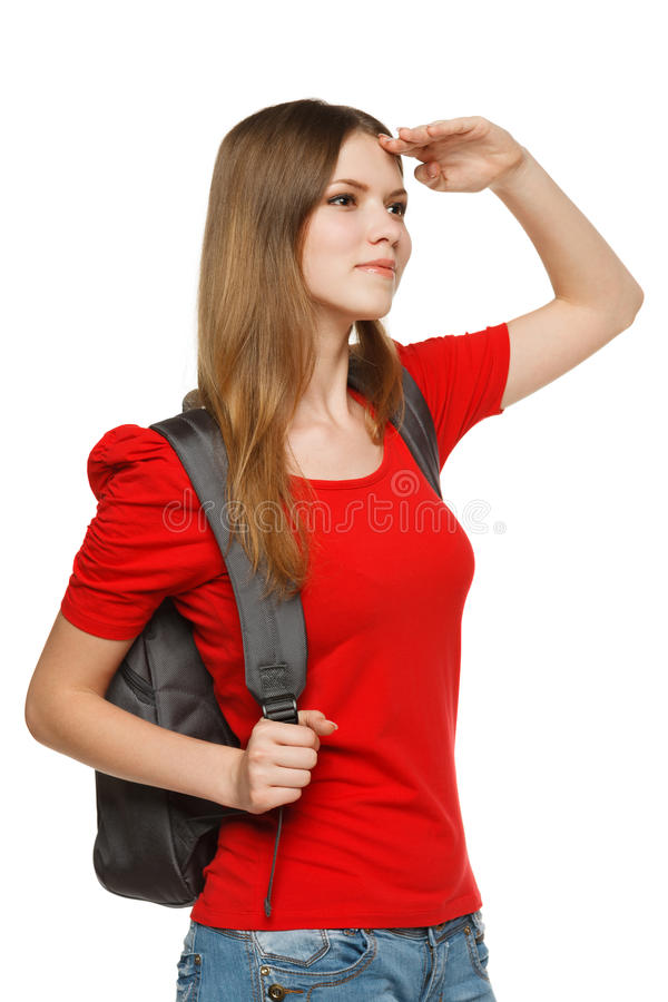 Teenager girl with backpack looking forward stock photography