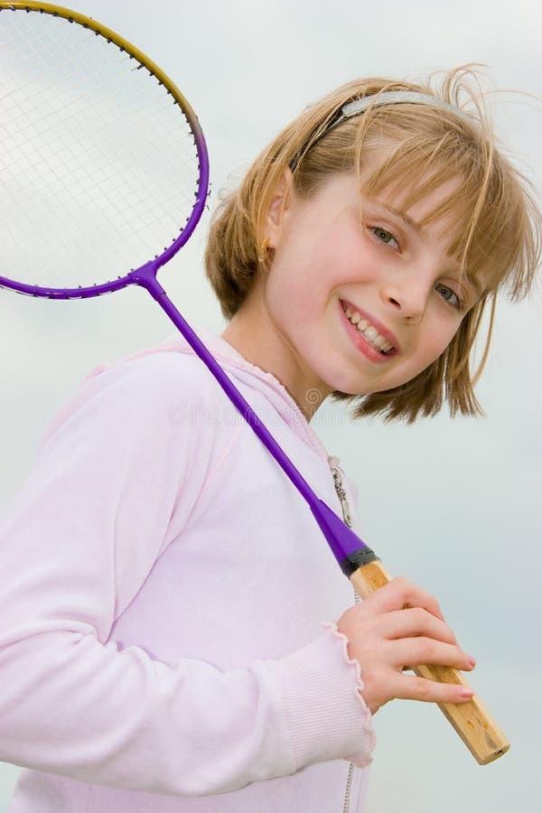 Teenager girl with badminton racket. Happy teenager girl with badminton racket royalty free stock photography