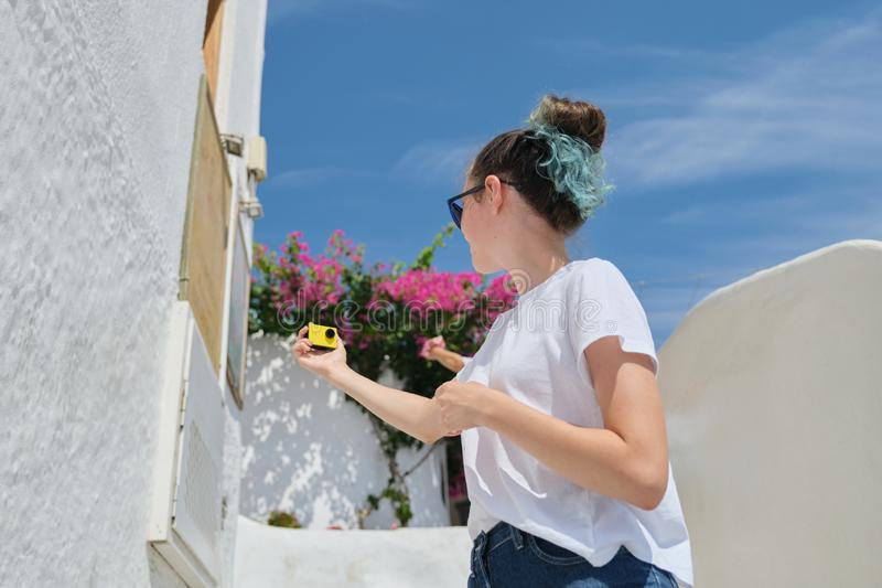 Teenager girl blogger recording video vlog from luxury travel to Mediterranean royalty free stock photography