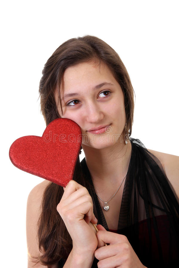 Teenager girl holding a heart