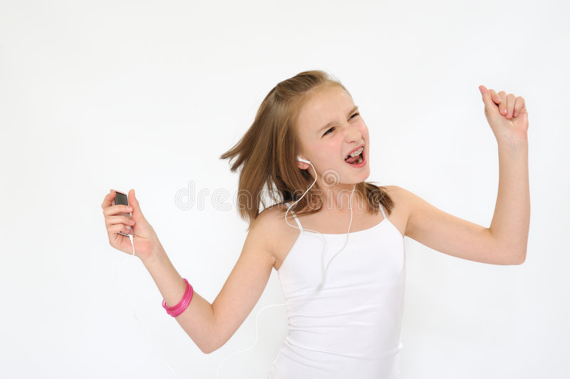 Teenager Girl Jamming. Pretty young girl jamming listening mp3 player stock images