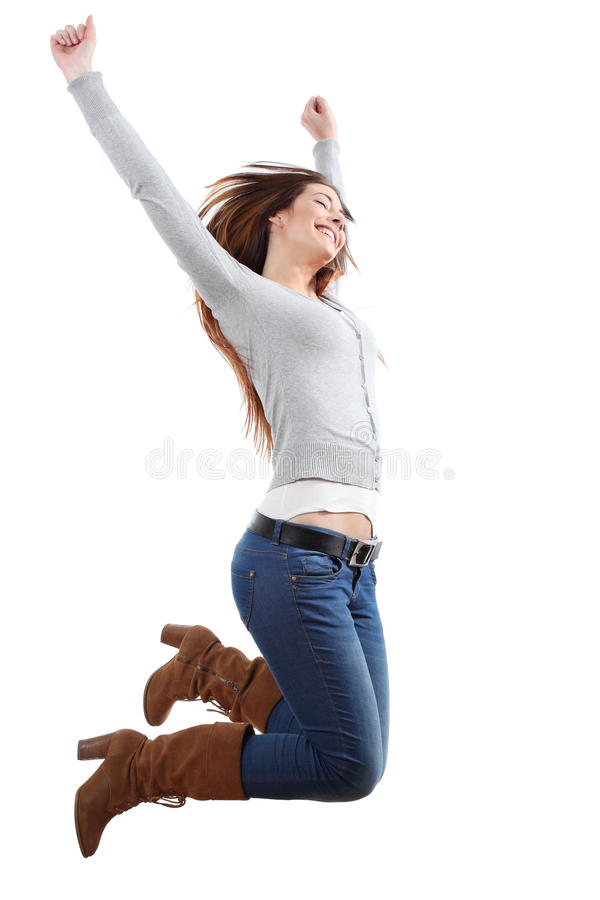 Teenager girl jumping happy. With her arms raised on a white isolated background royalty free stock image