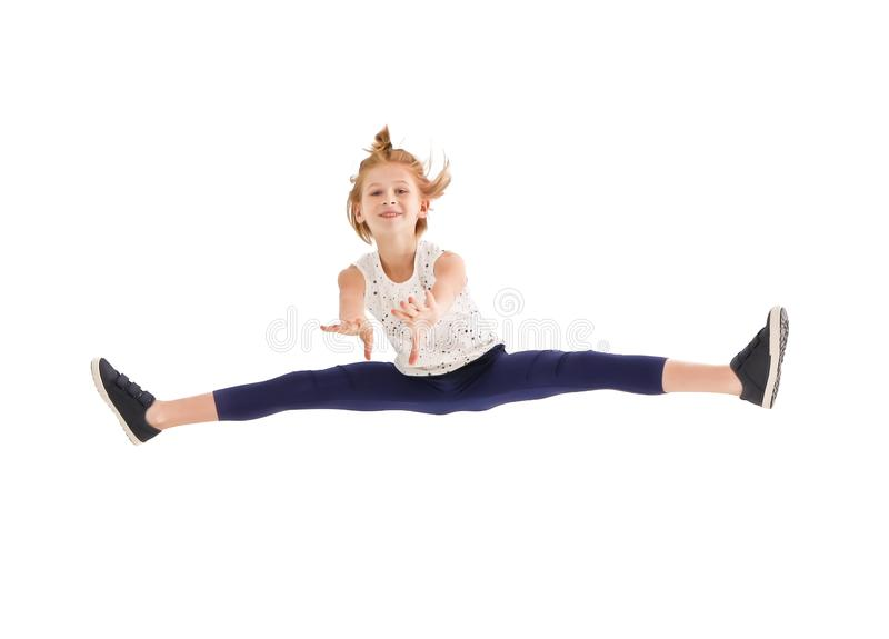 Teenager girl jumping on white background. Cute teenager girl jumping on white background royalty free stock photo