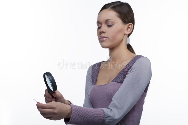 Teenager girl with magnifying glass stock image
