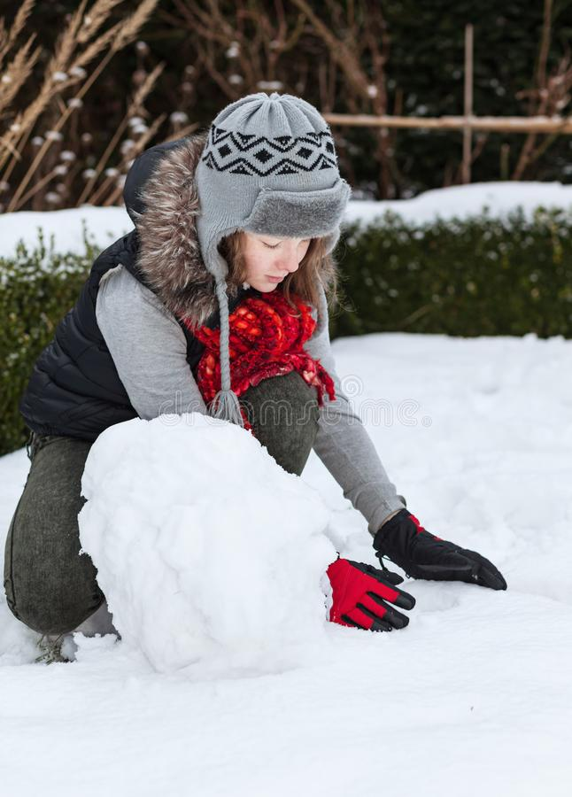 Download Teenager Girl Making Snowman Stock Image - Image of blond, curly: 105228275