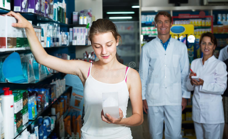 Teenager girl in pharmacy royalty free stock image