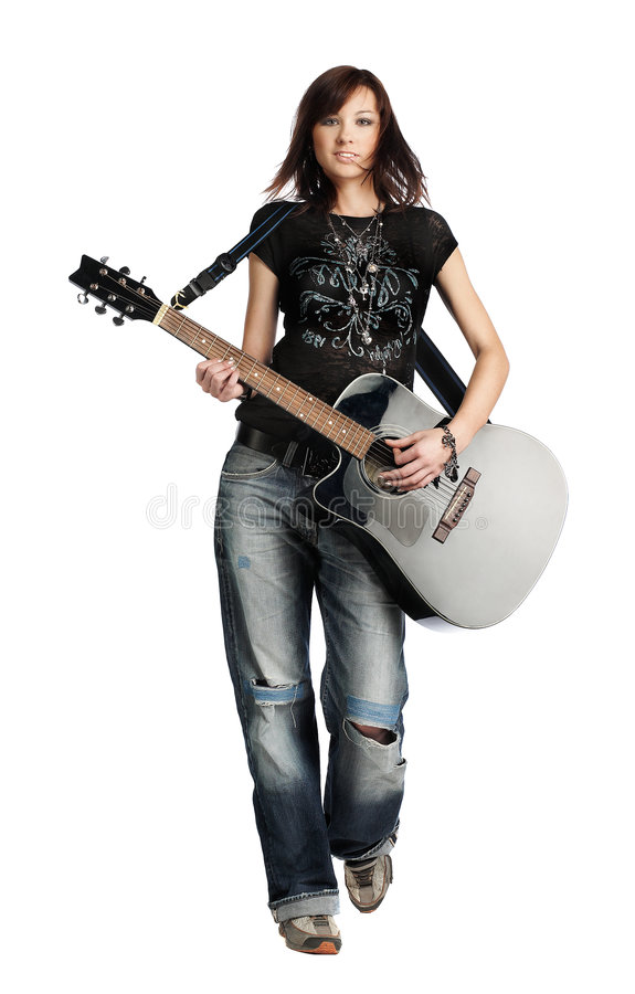 Teenager girl playing an acoustic guitar royalty free stock photos