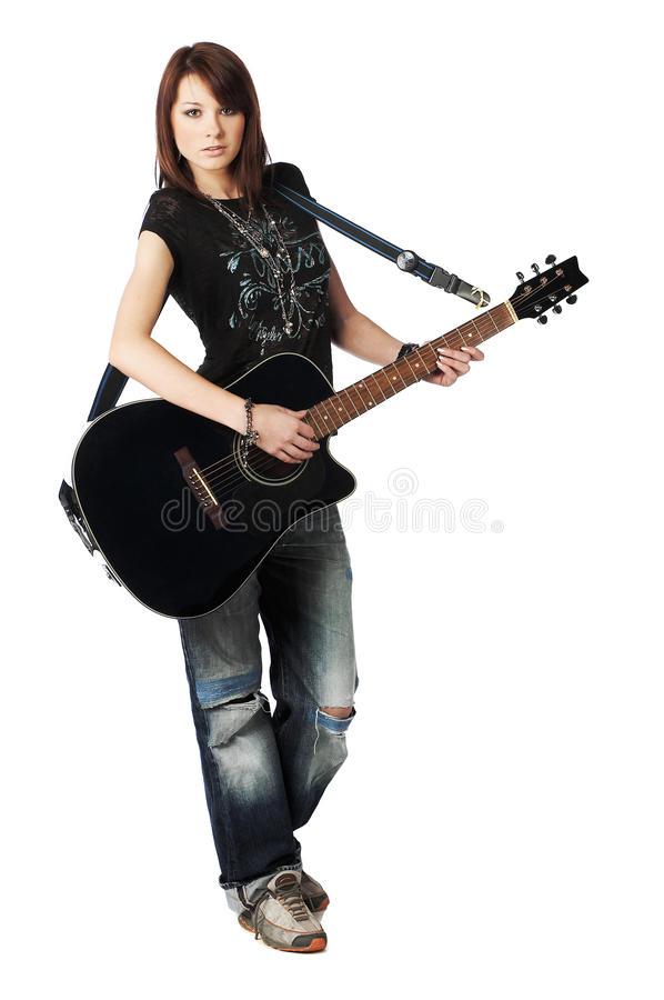 Teenager girl playing an acoustic guitar stock images